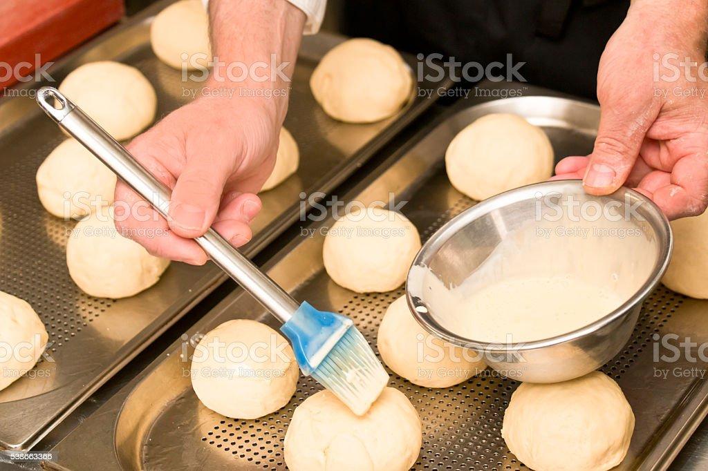 Chef Preparing Burger Buns stock photo