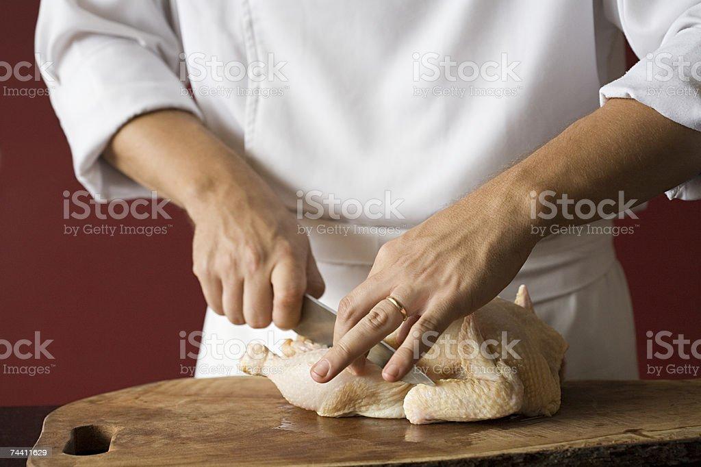 Chef preparing chicken royalty-free stock photo
