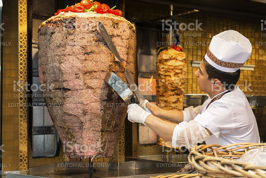 Chef preparing kebabs for sale stock photo