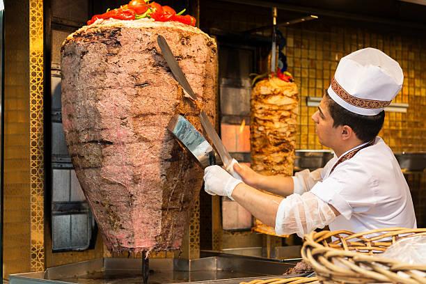chef preparing kebabs for sale - i̇stiklal caddesi stockfoto's en -beelden