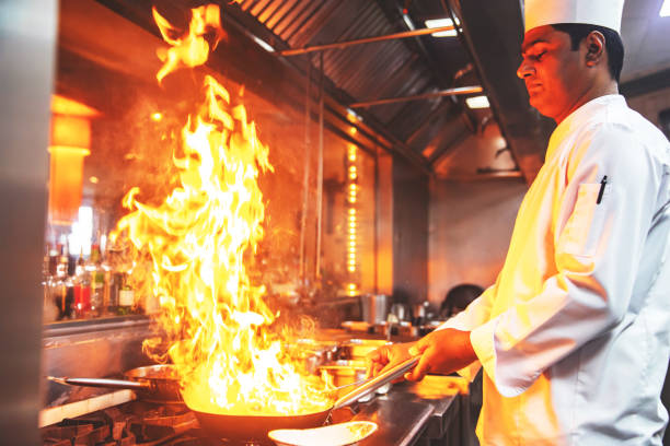 Chef Preparing Meals for Special Guests at a Restaurant stock photo