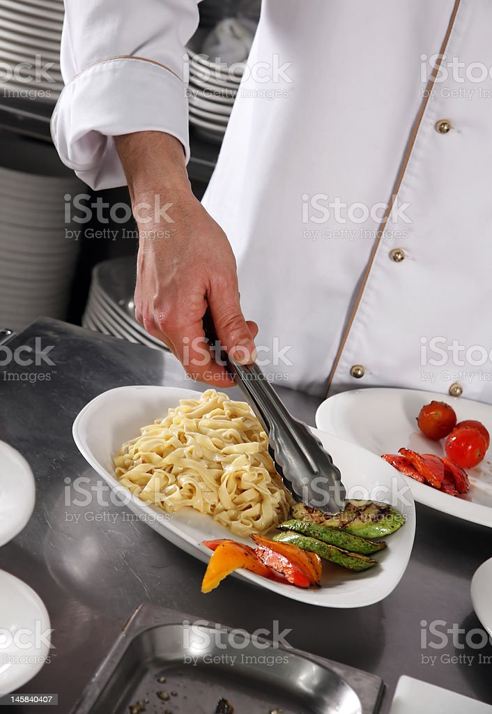 Chef preparing pasta royalty-free stock photo