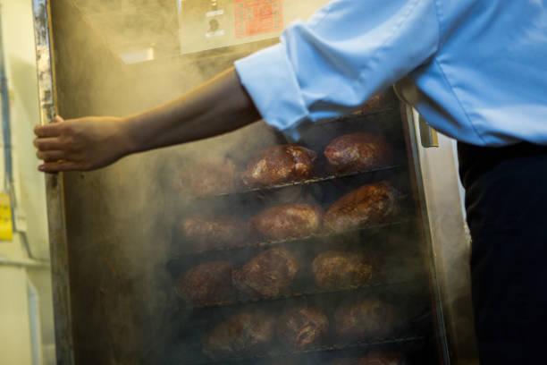 Chef preparing smoked meat stock photo