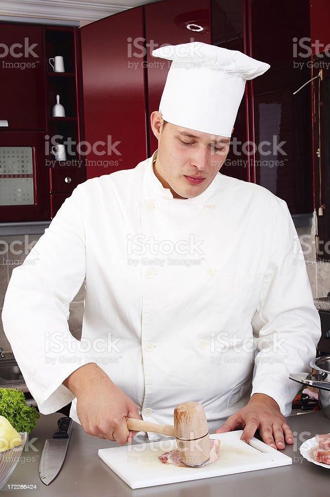 Chef preparing steak royalty-free stock photo