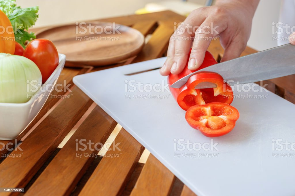 Chef preparing vegetable for cooking. stock photo