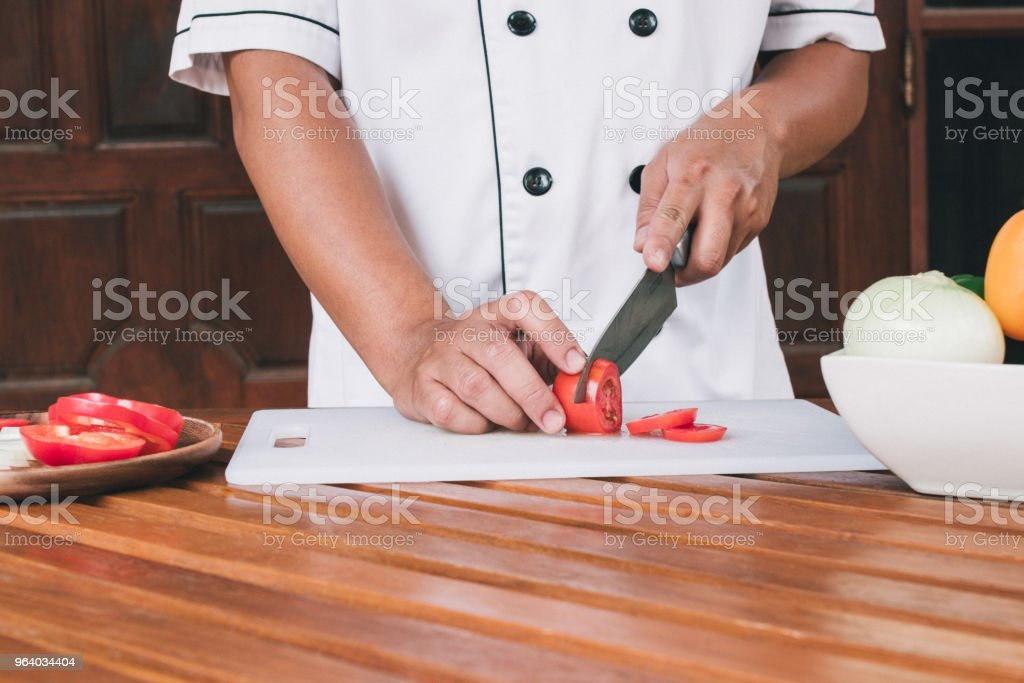 Chef preparing vegetable for cooking. - Royalty-free Adult Stock Photo