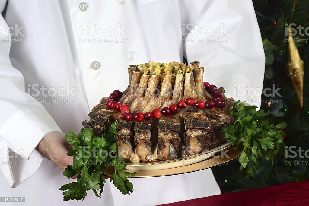 Chef Presenting Crown Roast of Pork royalty-free stock photo