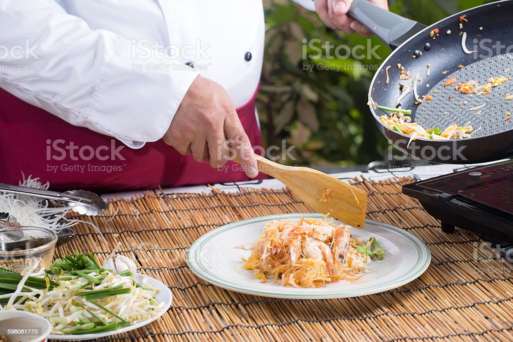 Chef putting Pad Thai to the plate royalty-free stock photo