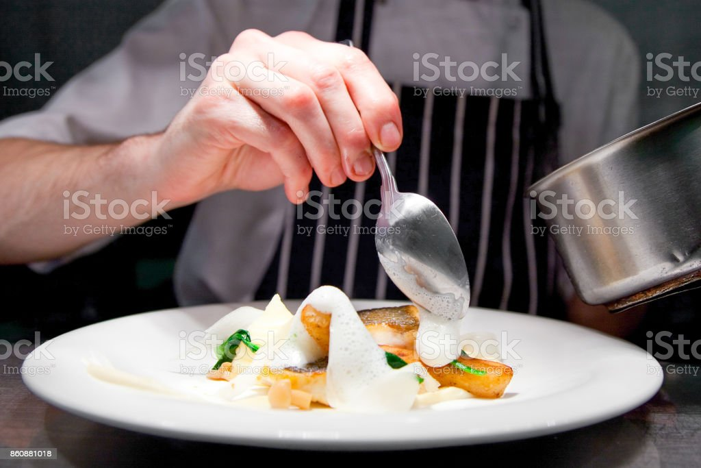 Chef restaurant kitchen cooking, only hands stock photo