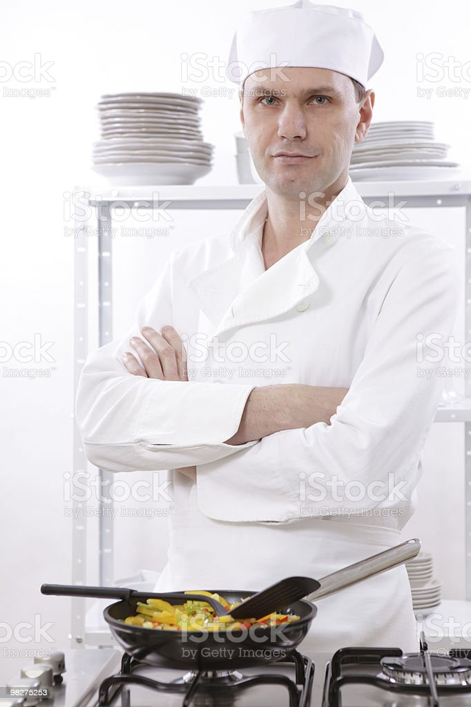 Chef roasting vegetables royalty-free stock photo