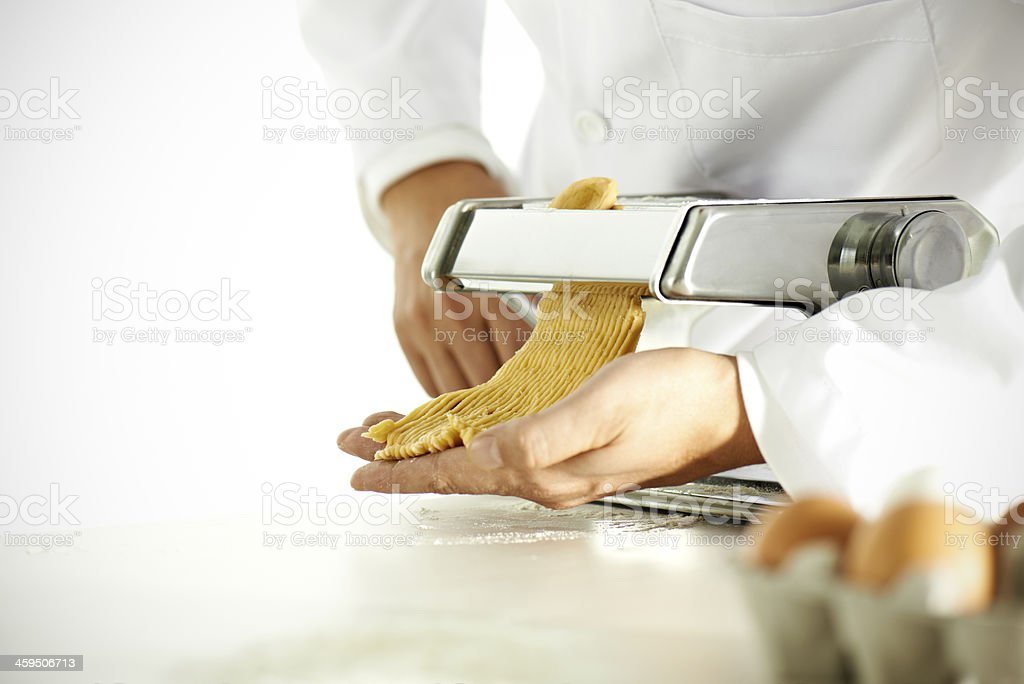 Chef Rolling Out Pasta Dough royalty-free stock photo