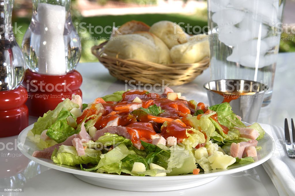 Chef salad on a picnic table stock photo