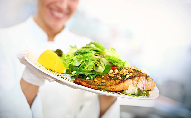 Chef serving a meal. stock photo