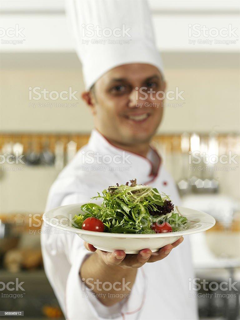 chef serving fresh salad royalty-free stock photo