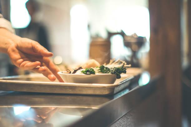 Chef Serving Ramen Bowls At A Japanese Pub stock photo