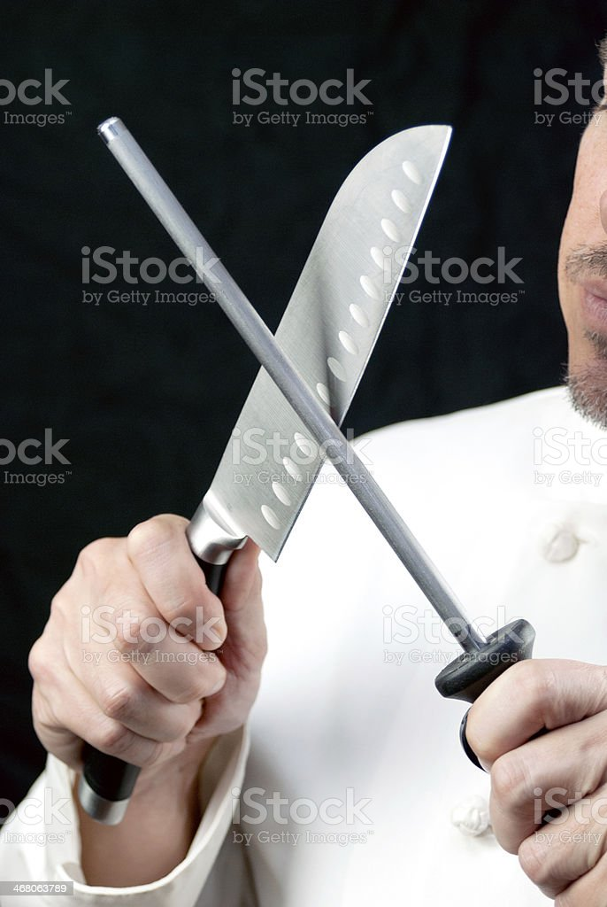 Chef Sharpens Knife, Side stock photo