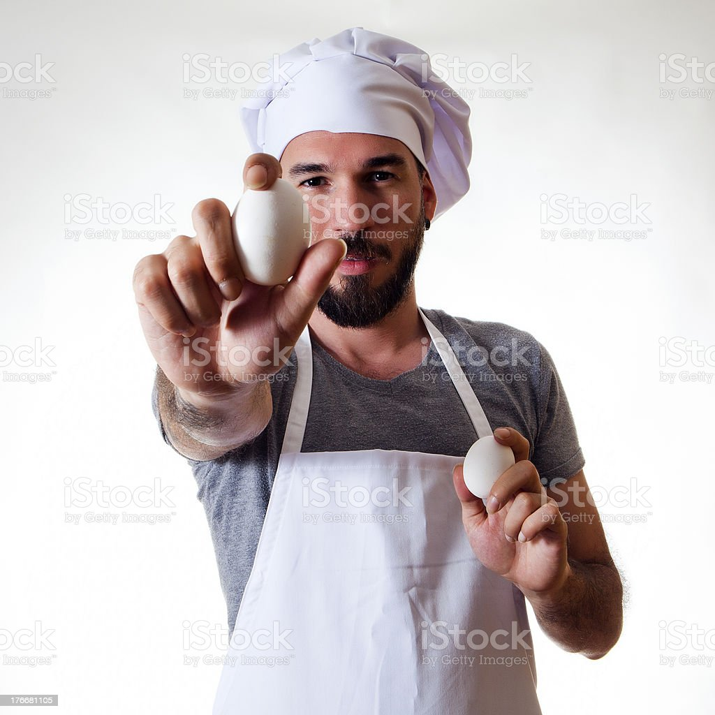 Chef showing an egg royalty-free stock photo