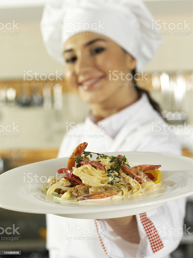 Chef Showing Pasta Plate royalty-free stock photo