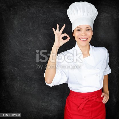 istock Chef showing Perfect hand sign and menu blackboard 1159612825