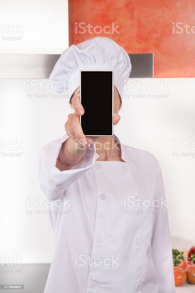 chef showing screen blank phone stock photo