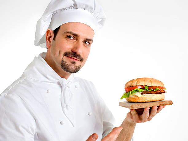 chef shows his delicious ham burger stock photo