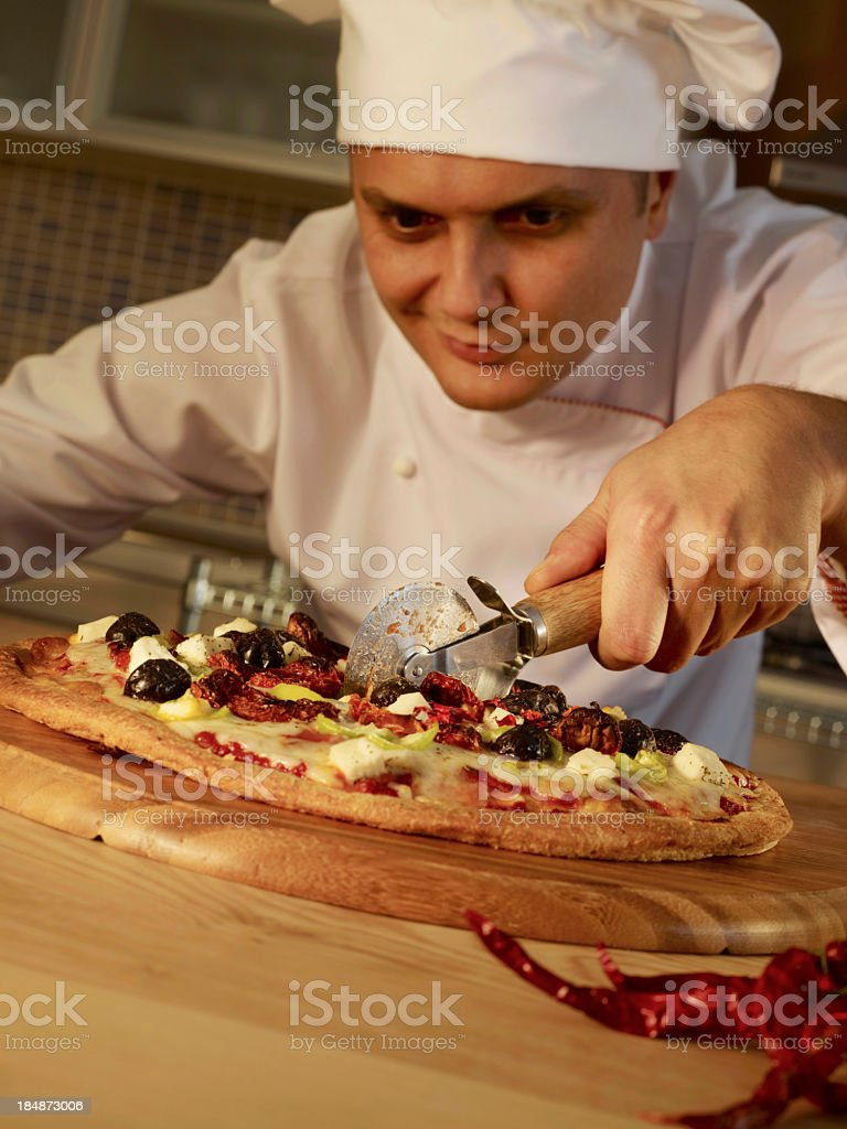 Chef Slicing Pizza royalty-free stock photo