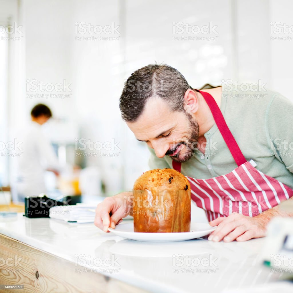 Chef smelling Panettone royalty-free stock photo