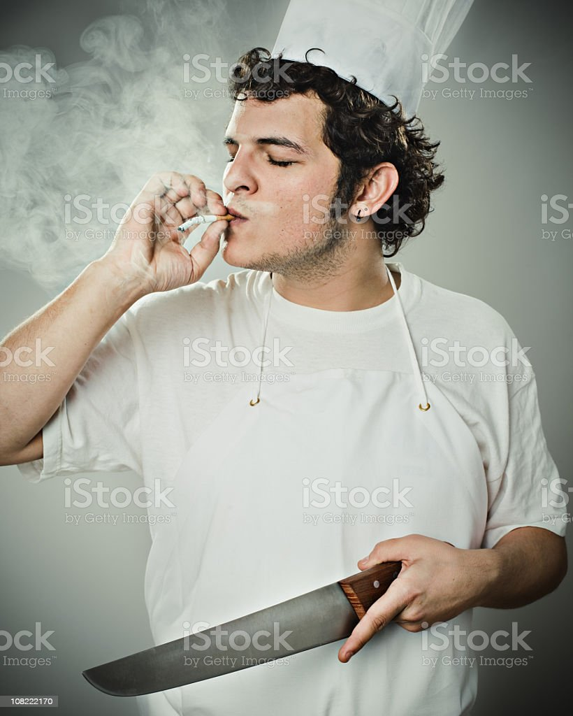 Chef Smoking and Holding Knife royalty-free stock photo