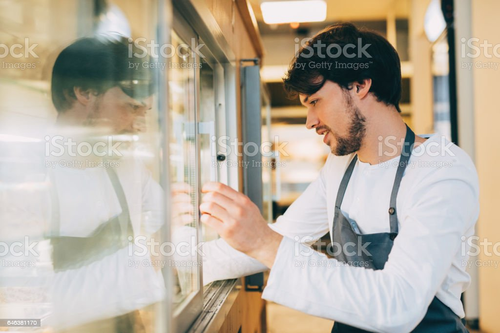 Chef  taking food out of the fridge stock photo