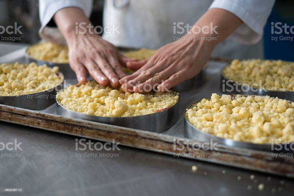 Chef Topping Cheese Cakes in Bakery stock photo