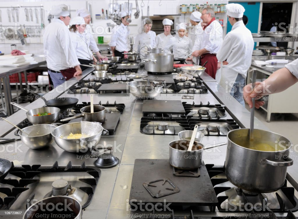 chef trainees in cooking class XXXL image stock photo