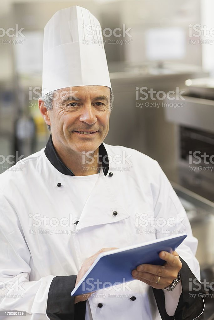 Chef using digital tablet royalty-free stock photo