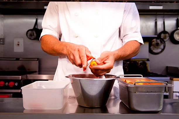 Chef who is preparing vegetables in the kitchen stock photo