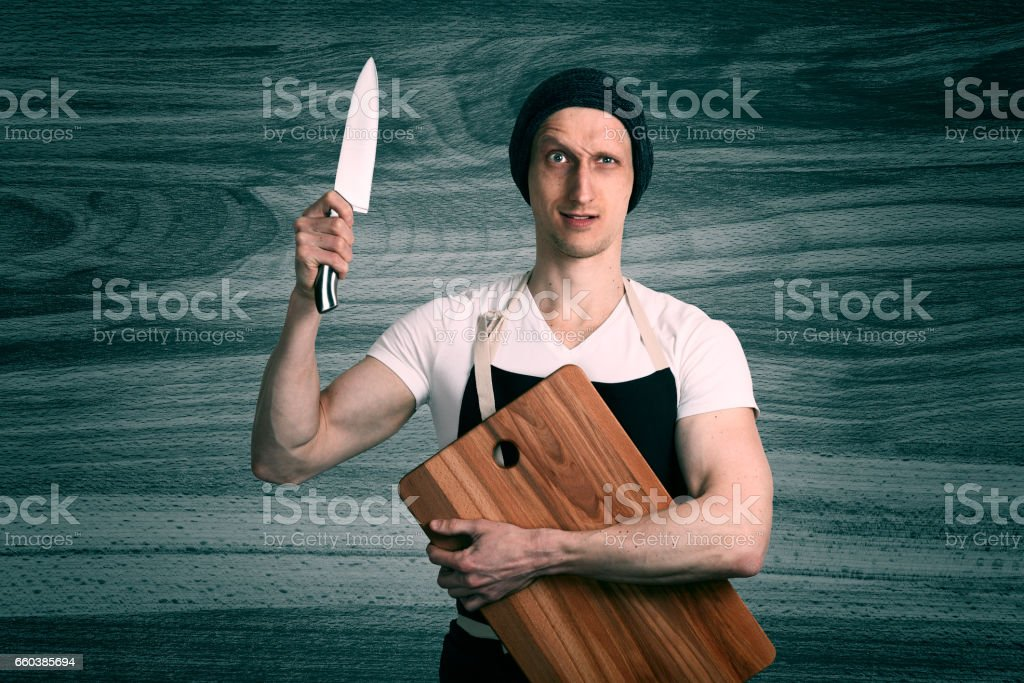 Chef With A Knife stock photo