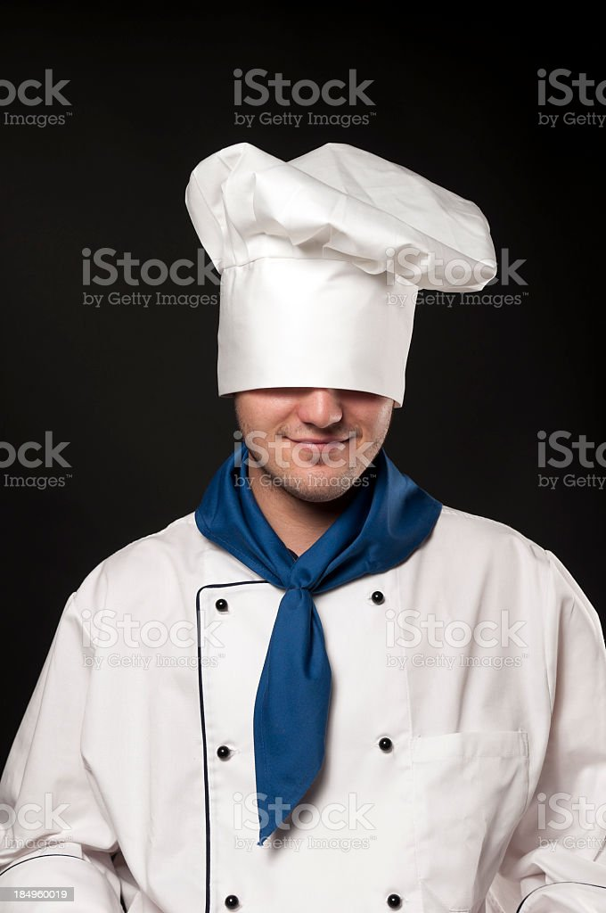 Chef with bonnet over his eyes, portrait royalty-free stock photo