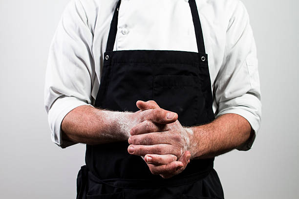 chef with flour on hands - apron stock pictures, royalty-free photos & images