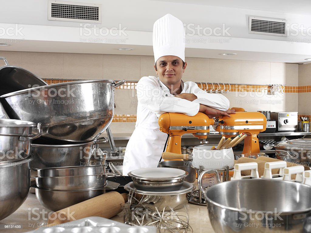 Chef with kitchen utensils royalty-free stock photo