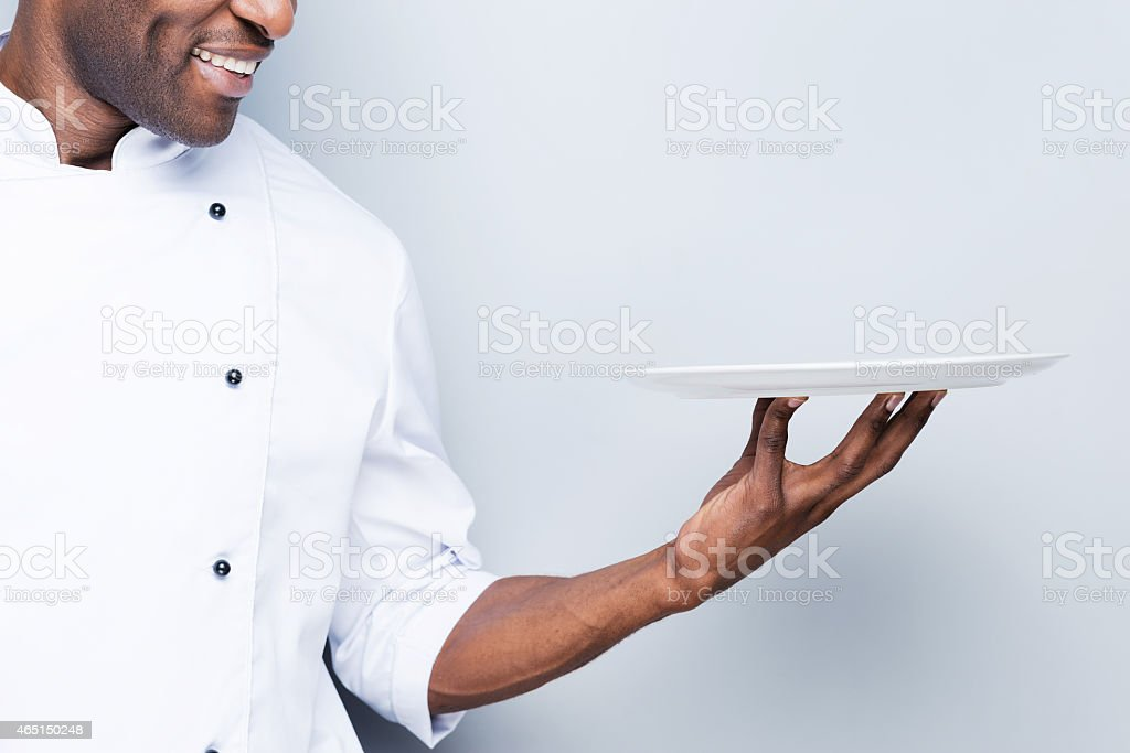Chef with plate. stock photo