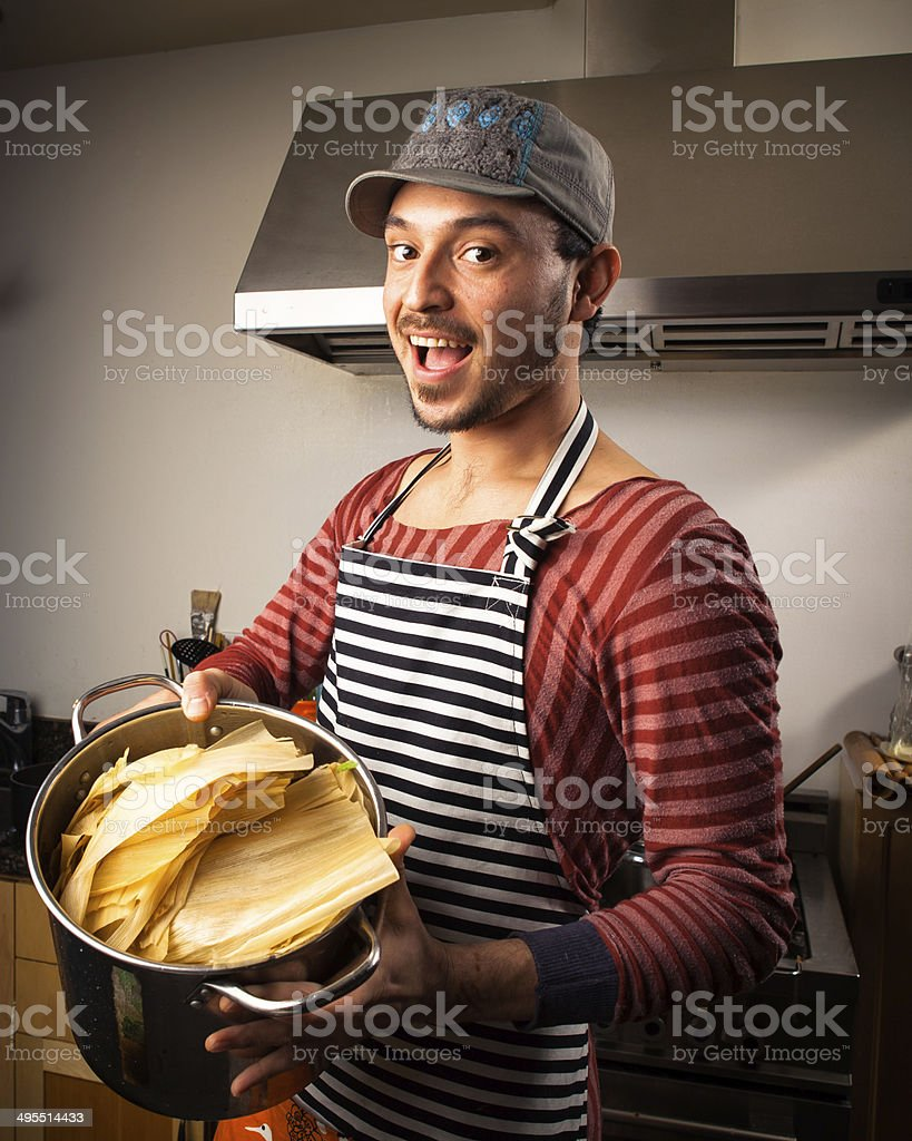 Chef with Pot of Corn Husks royalty-free stock photo