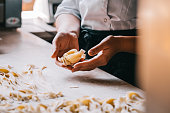 istock Chef woman's hands making pasta 1027385116