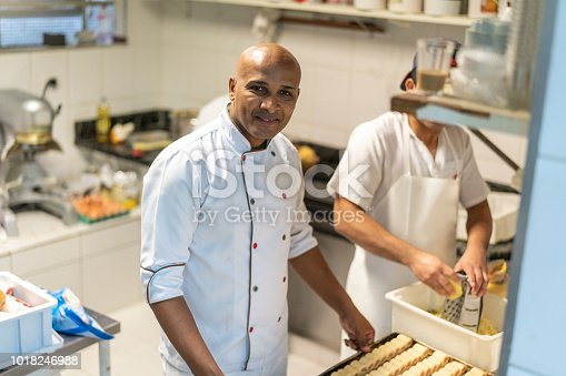 istock Chef working at commercial kitchen 1018246988