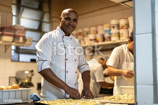 istock Chef working at commercial kitchen 1018259458