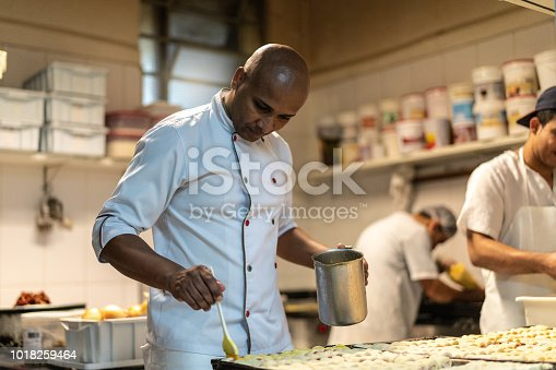 istock Chef working at commercial kitchen 1018259464