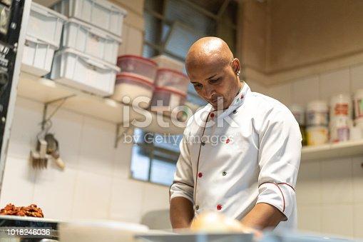 istock Chef working at industrial kitchen 1018246036