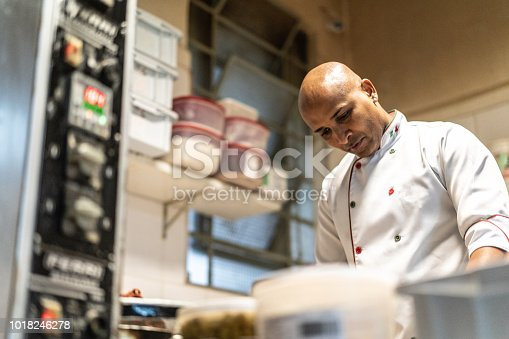 istock Chef working at industrial kitchen 1018246278