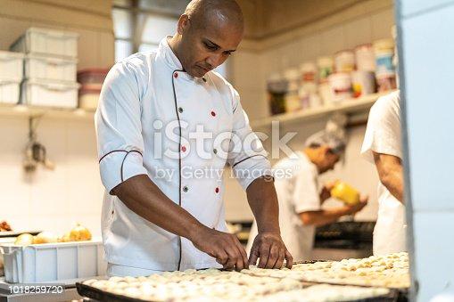 istock Chef working at industrial kitchen 1018259720