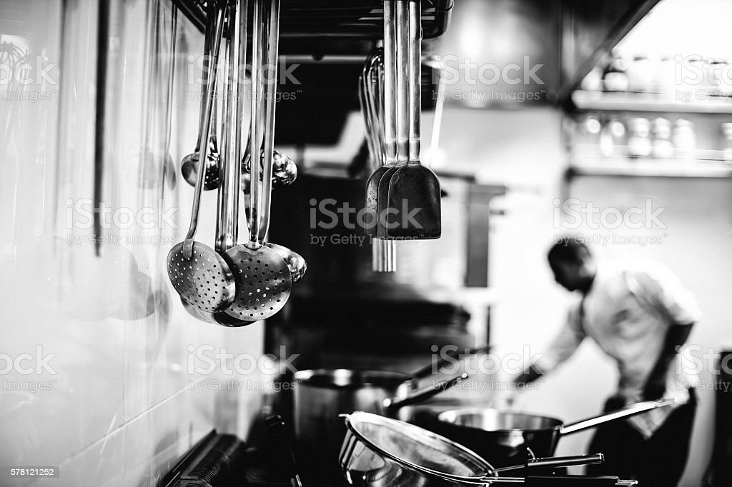 Chef working in a kitchen stock photo