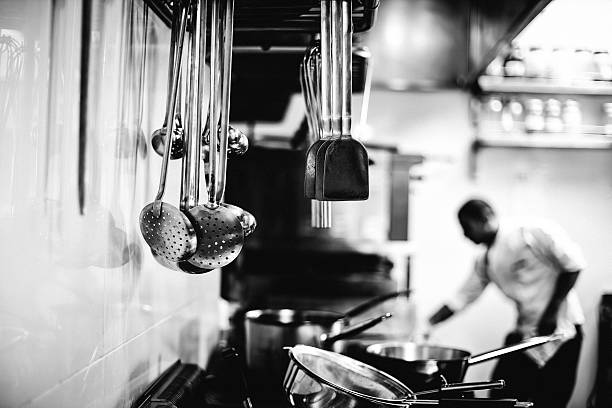 Chef working in a kitchen Chef working in a kitchen - Black and white image cooking black and white stock pictures, royalty-free photos & images