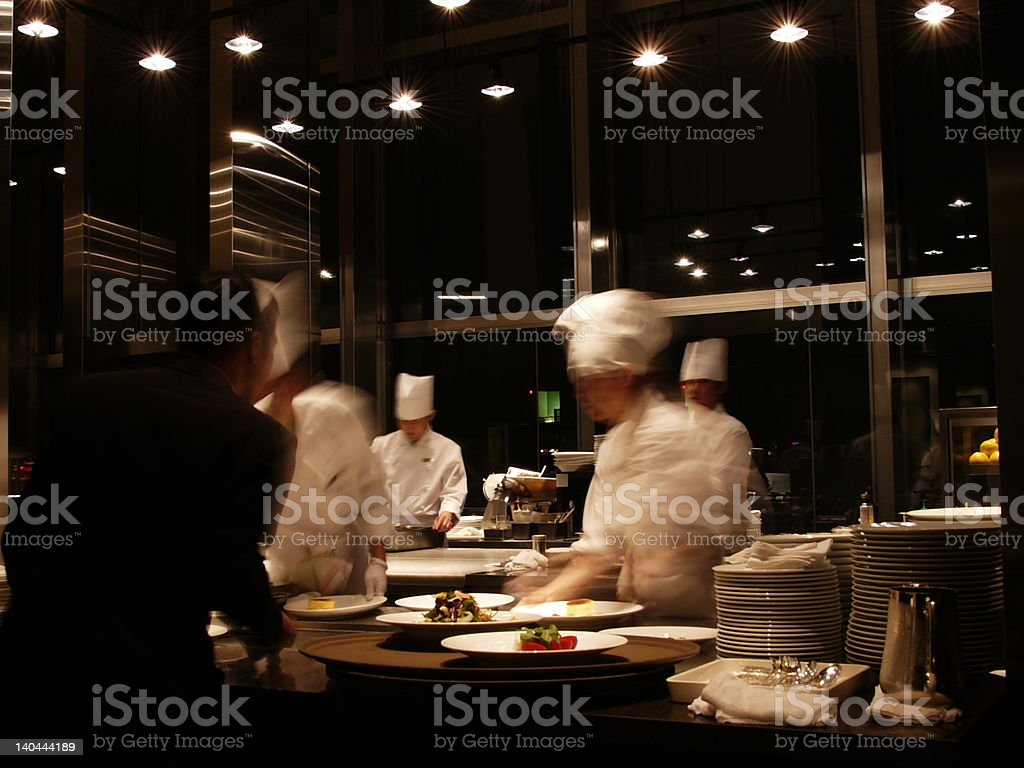 Chefs and waiter at work stock photo