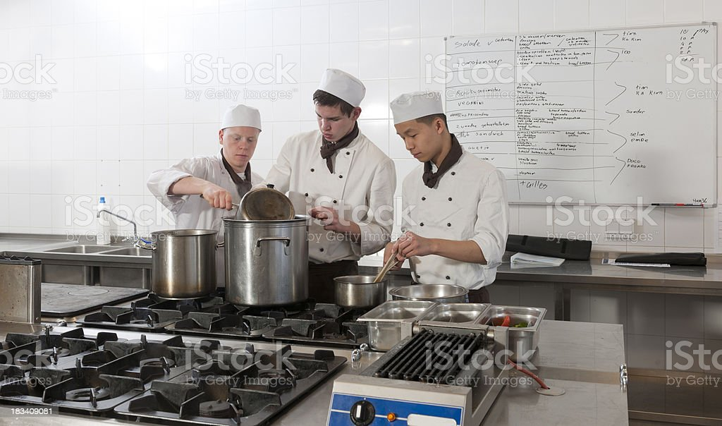 chefs at work in restaurant kitchen royalty-free stock photo